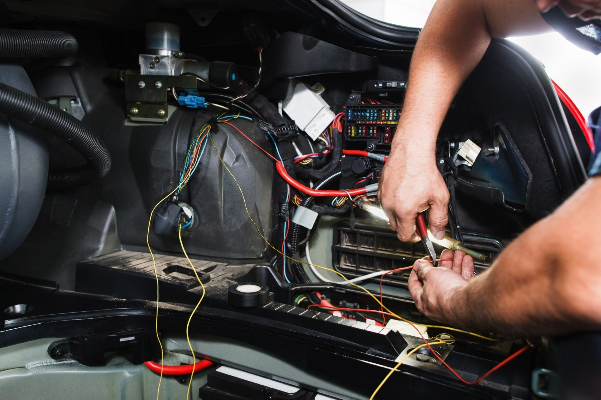mechanic running diagnostics on a vehicle